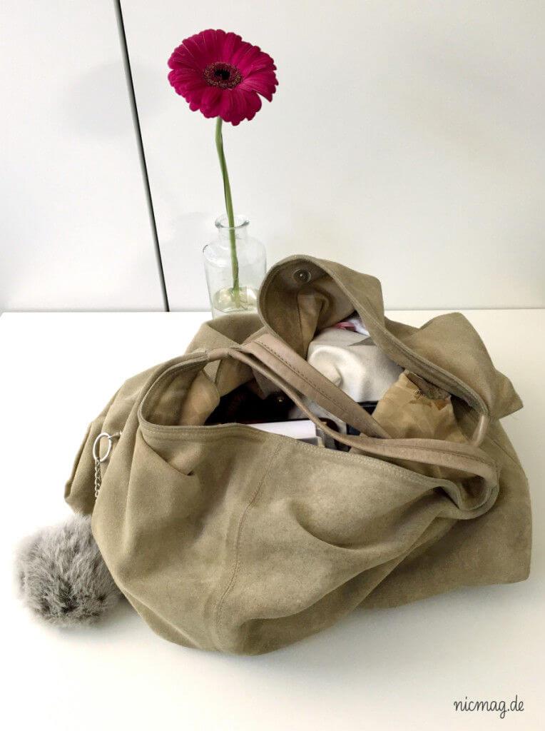 Tasche und Puschel